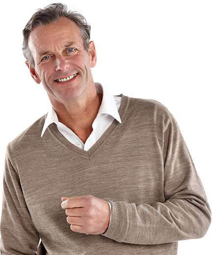man in tan sweater smiling