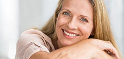 An older woman with dental implant in St. Peters smiling