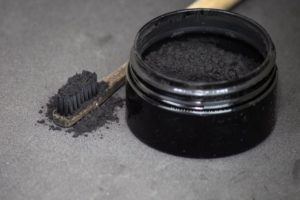 toothbrush with activated charcoal powder on it