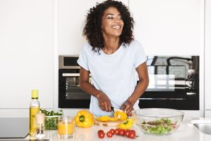 person cooking healthy food