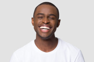 man with beautiful smile after getting a smile makeover